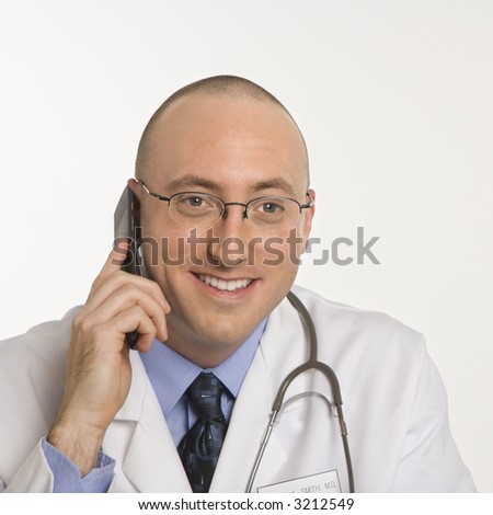 Caucasian mid adult male physician talking on cellphone. - stock photo