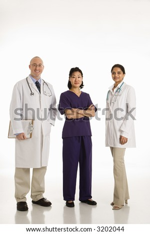 Caucasian mid adult male physician with Asian and Indian women doctors.