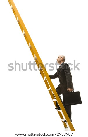 Caucasian middle-aged businessman climbing ladder carrying briefcase. - stock photo