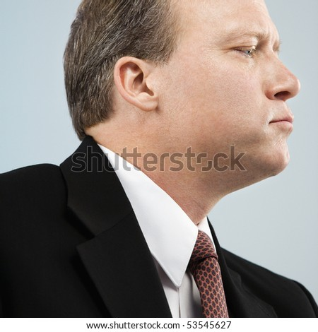 Caucasian middle aged businessman profile portrait. - stock photo