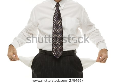 Caucasian middle-aged businessman pulling empty pockets out standing against white background. - stock photo