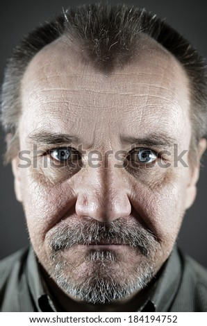 caucasian  middle-aged man with a mustache and beard closeup - stock photo
