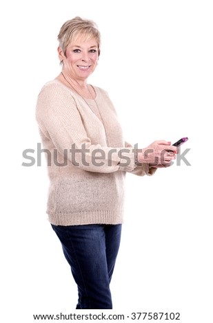 caucasian middle aged woman using her cellphone - stock photo