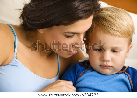Caucasian mom with toddler son. - stock photo