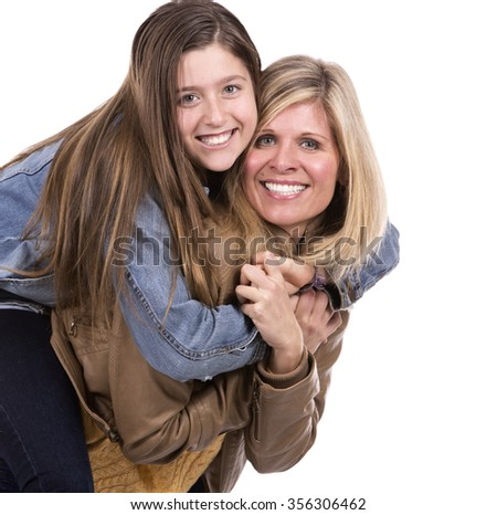 caucasian mother and daughter on white studio background