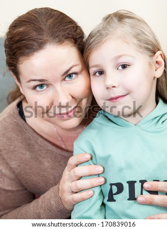 Caucasian mother face to face with preschooler daughter - stock photo