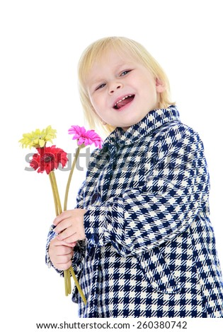 Caucasian pretty little girl with a bouquet of flowers in their hands - isolated on white.