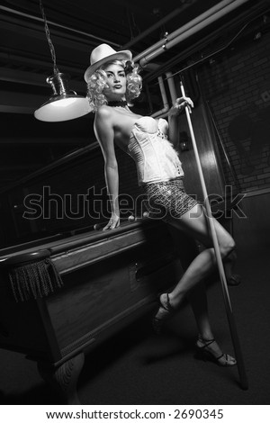 Caucasian prime adult female standing in front of pool table. - stock photo