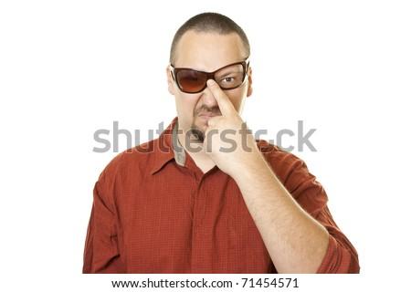 Caucasian retro nerd man in red t shirt with fancy  broken glasses - stock photo