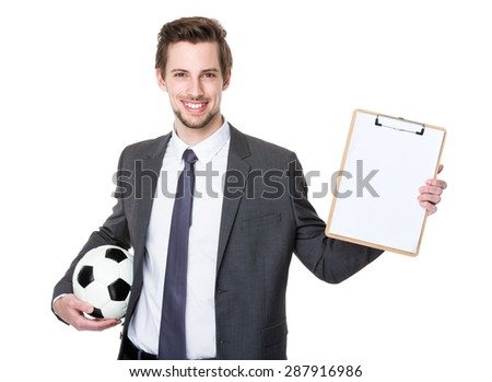 Caucasian scooer manager holding with football and showing with clipboard - stock photo
