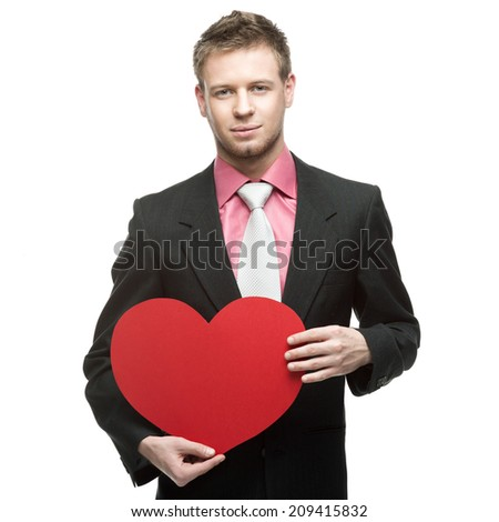 caucasian smiling businessman in gray suit holding red heart isolated on white background - stock photo