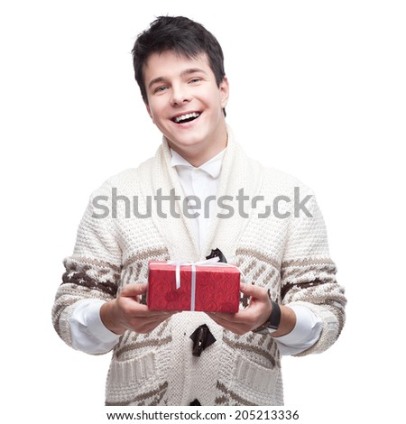 caucasian smiling casual young man holding gift. isolated on white - stock photo