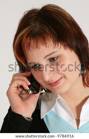 Caucasian teenage girl with happy smiling facial expression using mobile phone. - stock photo