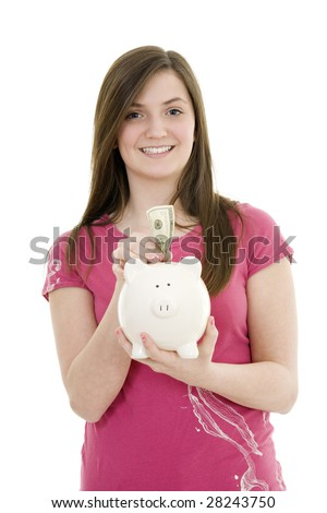Caucasian teenager holding a piggy bank on white background