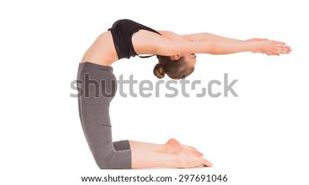 Caucasian woman exercising yoga in camel pose in studio on white background. - stock photo