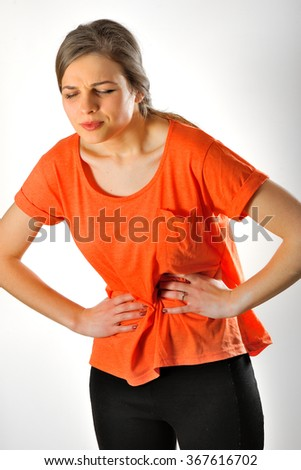 Caucasian woman having abdominal pain - stock photo