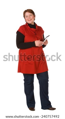 Caucasian woman in burnt orange top and blue denim with a tablet - stock photo