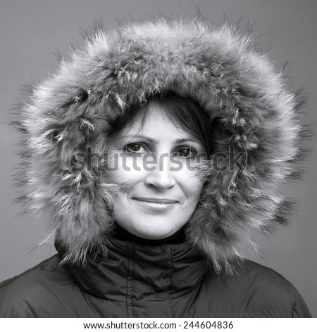 Caucasian woman in fur hood - stock photo