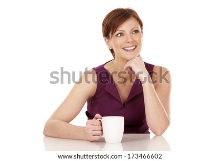 caucasian woman in her 30s drinking cup of coffee on white background