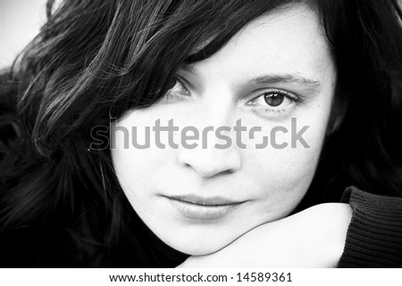 Caucasian woman in pensive expression