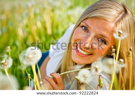 Caucasian woman in spring field - stock photo