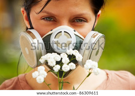 caucasian woman is wearing a gas mask