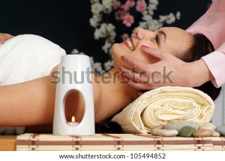 Caucasian woman lying on a massage in the spa salon - stock photo
