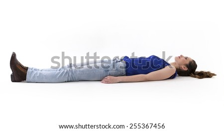 Caucasian woman lying on floor. Full-length image. Isolated on white background. - stock photo