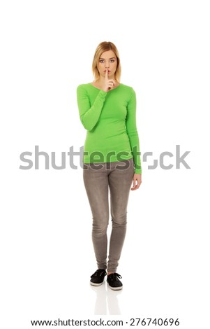 Caucasian woman making hush gesture. - stock photo