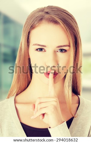 Caucasian woman making silent sign - stock photo