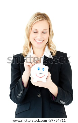 Caucasian woman putting money in a piggybank against a white background - stock photo