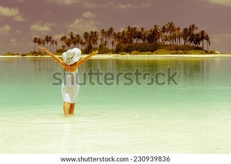 Caucasian woman rests at beautiful seashore - stock photo