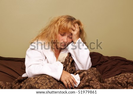 Caucasian woman sick in bed with the flu