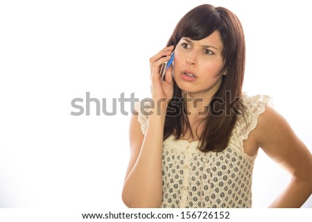 Caucasian woman talking on a cellphone white background - stock photo