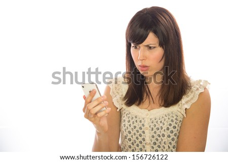 Caucasian woman talking on iphone cellphone white background
