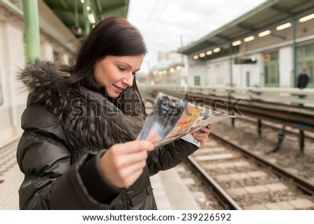 caucasian woman waiting at the railway station - stock photo
