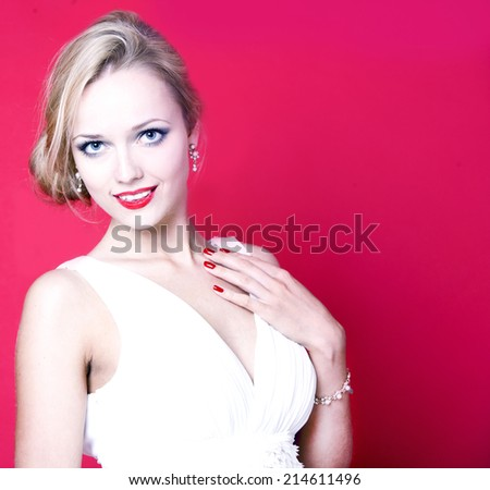 Caucasian woman wearing white dress on red background - stock photo