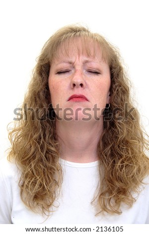 Caucasian woman with her eyes closed looking very depressed and unhappy. Isolated on white. - stock photo