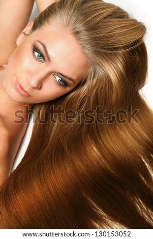 Caucasian woman with long beautiful blond hair isolated over white background