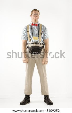 Caucasian young man dressed like nerd looking at viewer. - stock photo