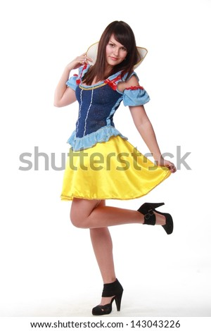 Caucasian young woman in a beautiful dress fairytale character on Holiday - stock photo