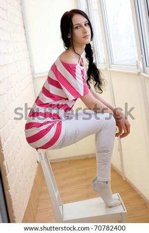 Caucasian young woman on the chair - stock photo