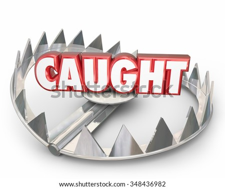 Caught word on a steel bear trap to illustrate danger of being captured - stock photo