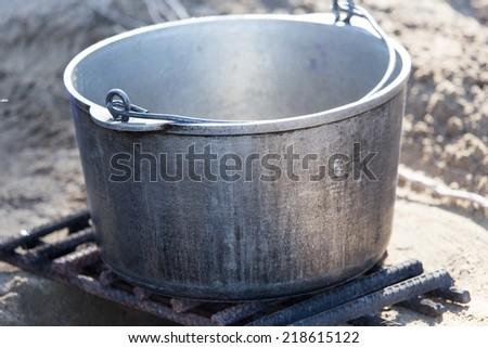 cauldron on the nature - stock photo