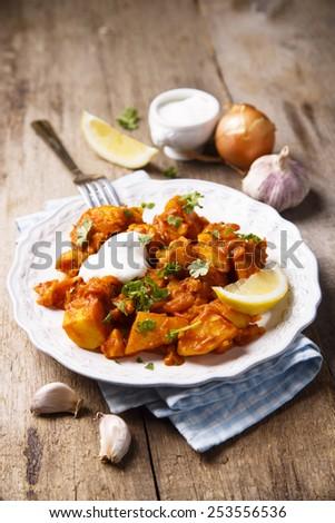 Cauliflower and potato curry - stock photo