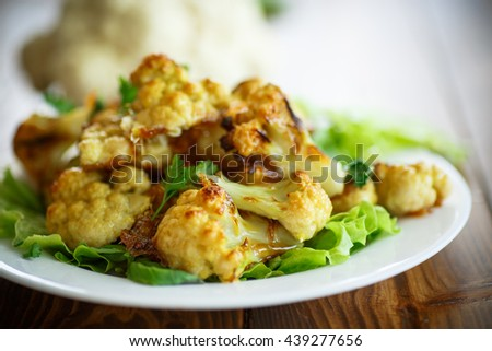 cauliflower baked in batter on the plate - stock photo