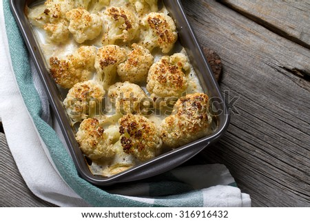 Cauliflower cheese in a ceramic baking form - stock photo