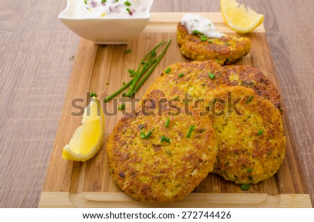 Cauliflower curry pancakes with spicy dip of Greek yogurt, chives and lemon juice - stock photo