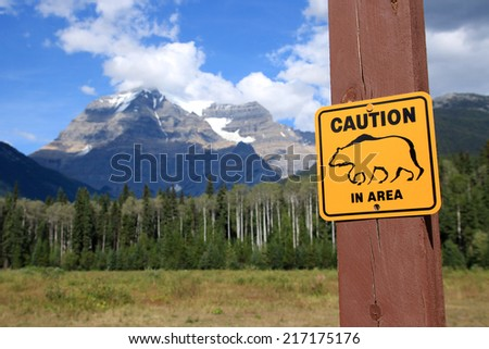 Caution Bear in Area sign at Mount Robson, Mount Robson Provincial Park, British Columbia, Canada - stock photo