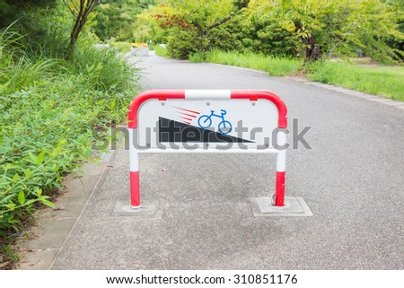 Caution downhill bike signs  slope. - stock photo